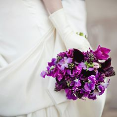 Brides.com: Bouquets from Real Weddings. Bridal Bouquet of Calla Lilies, Tulips, Orchids and Hyacinths. This bouquet is fit for a regal affair with its deep purple hue and sophisticated calla lily and orchid blooms.  See more photos from this vintage-inspired wedding.