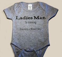 Very cute handcrafted baby boys bodysuit that says Ladies Man - In Training (currently a Mamas boy) is perfect for a gift for someone else or for