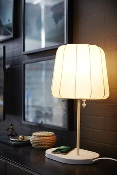 Easily charge your smartphone wirelessly with the IKEA VARV table lamp with wireless charging! Just place your phone on the charging pad to bring life back into your device.