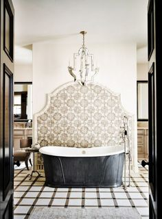 A washtub and graphic tiles make a statement in a small space
