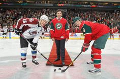 Former Colorado Avalanche and Minnesota Wild player Andrew Brunette drops the ceremonial first puck at the Avs @ Wild game on February 14, 2013.