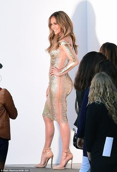 Stunning: Jennifer Lopez showed off her flawless figure in a gold dress at American Idol o... http://dailym.ai/1f92reL#i-ab7f0e80