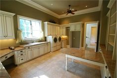 Large laundry room with plenty of space & large table for folding and drop down ironing board too! Love this!