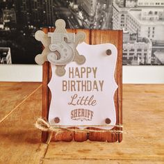 """Little Sheriff Card. Cardstock: Folia; DP: Kaisercraft; stamps: Waltzing Mouse (""""Sheriff""""), Papermania (""""Carnival Numbers""""), Stampendous (""""Grunge Birthday""""), MFT (""""Baby Onesie""""); embossing powder: Ranger; ink: SU; brads: Rayher; twine from my stash."""