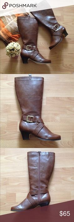 """Equestrian Brown Boots Equestrian wide-calf tall brown boots w/ gold buckle & criss-cross design around ankle in size 10.5 WW. Never worn! Full-zip, rounded toe & elastic-band slit around calf. Heel: 2.5"""", shaft height: 18"""" & shaft width: 9"""". Has a few scuffs from storage (see pics), but barely noticeable! Zipper on left boot is a little stiff at very top, but works great! Chic & stylish addition to your fall wardrobe!! 🍁🍂 Step-Up Shoes Heeled Boots"""