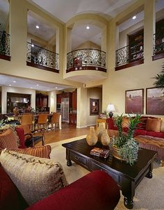 Lovely two story Great Room, beautiful wrought iron railing...warm and inviting