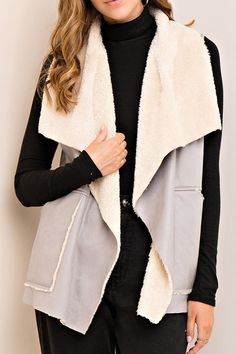 This gray faux suede vest has a cream shearling lining. This vest has side opens and an open, waterfall draped front. Shearling Vest, Vest Outfits, Gray, Fashion, Vest Coat, Moda, Fashion Styles, Grey, Fashion Illustrations