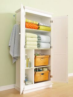 Customized Linen Closet - we totally need this with our lack of storage in bathroom.  Can use existing cabinets or a freestanding unit.