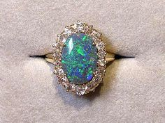 Black Opal and Diamond Oval Ring