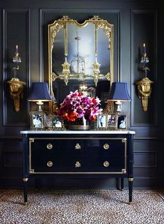 Home decorating ideas - Dramatic black, elegant side table vignette with pops of gold.
