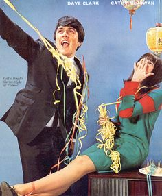Cathy McGowan & Dave Clark posing for Rave party feature, December 1964