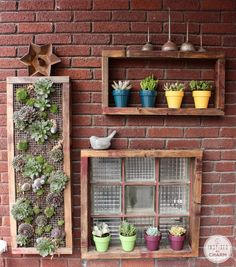 Inspired by Charm | Organic outdoor wall art. Shelves + succulent wall hanging + cheerful pots of plants