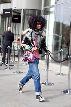Ok, this is not my style per say.  Her hair is fierce and the jeans look comfy, but she really had me at the gray converse...