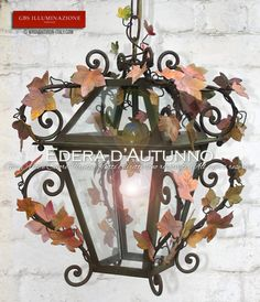 Lanterna in ferro battuto e decorato a mano. Colori dell'Autunno. Per interni ed esterno. Girali forgiati. GBS Firenze. All rights reserved. wroughtiron-italy.com Design: Gianni Cresci