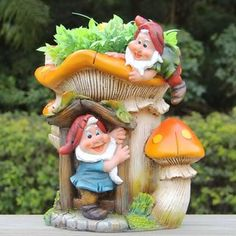 The SINTECHNO Two Gnomes with Orange Mushroom House Flower Pot Planter sets a cheery tone wherever you place it. Grow something green through the roof. Painted Flower Pots, Flower Planters, Planter Pots, Resin Planters, Orange Mushroom, Create A Fairy, Gnome Statues, Garden Statues, Growing Mushrooms