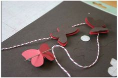 ooh, cool way to string butterflies. Never thought of this, but I love it. Butterfly garland for spring an party decorations, here I come.
