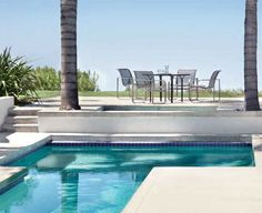 an outdoor pool, patio & place to sit and relax