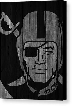 Oakland Raiders Wood Fence Canvas Print by Joe Hamilton.  All canvas prints are professionally printed, assembled, and shipped within 3 - 4 business days and delivered ready-to-hang on your wall. Choose from multiple print sizes, border colors, and canvas materials.