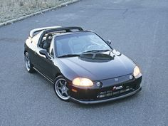 Honda CRX Del Sol...roof leaked, but I loved that lol car.