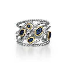 Sterling silver and 14kt yellow gold filigree style wide sapphire band consisting of pave set round blue sapphires and cable accents.  - http://www.barmakian.com/