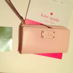 Kate Spade Pale Pink Wallet NWT! New authentic from Kate Spade. Big and gorgeous wallet with lots of compartments.  Color is pale pink, chic and trendy! New with tags and care card Store bag from KS included No trades kate spade Bags Wallets