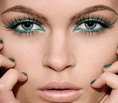I adore this! looks like a little teal liquid liner on top lash line, and teal pencil on bottom lash line!