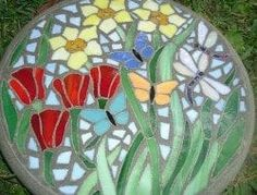 Stained glass and concrete stepping stone. Beautiful, bright stained glass depic… Stained glass and concrete stepping stone. Stone Mosaic, Mosaic Glass, Stained Glass, Pebble Mosaic, Concrete Stepping Stones, Garden Stepping Stones, Concrete Garden, Cement Patio, Diy Concrete