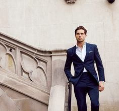 Fitted blue suit, no tie.