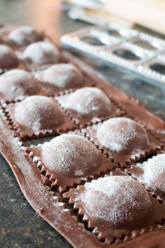 This chocolate ravioli with white chocolate mascarpone filling and raspberry sauce is an elegant, romantic, and unique dessert that is sure to impress!   www.pinchmeimeating.com