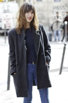 Oversized pea coat, navy, denim, dark red lips, messy hair.