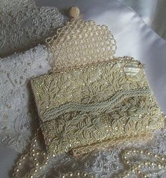 "Vintage wedding purse, white mother of pearl accented purse with beaded shoulder strap LAYAWAY PLANS by ""HopscotchCouture"" on Etsy Vintage Clutch, Vintage Purses, Vintage Bags, Vintage Handbags, Vintage Outfits, Vintage Items, Beaded Purses, Beaded Bags, Bridal Clutch"