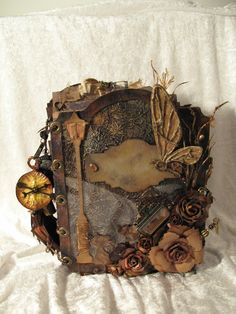 Tim Holtz. Mini album looks like Narnia. Rustic, steampunk, masculine, time cogs, keys. Browns and tea dye.