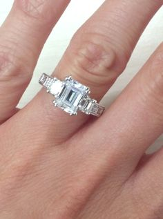 "Kirk Kara ""Charlotte"" Emerald Cut Three Stone Diamond Engagement Ring in 18kt White Gold. Style K1384DE-R"