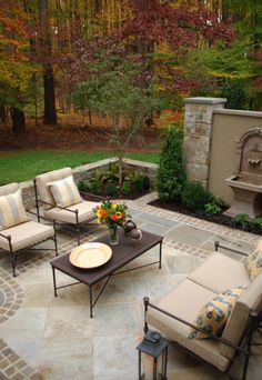 patio with border - I like this detail, however would it make our small-ish patio area appear even smaller? I really like the material they used for their patio here. I would prefer a thinner border.
