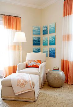 I LOVE the blue and orange color scheme here..and the pictures wrapping around the corner seem to open the space <3