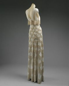 Evening dress Designer: Madeleine Vionnet (French, Chilleurs-aux-Bois 1876–1975 Paris) Date: spring/summer 1938 Culture: French Medium: rayon Dimensions: Length at CB: 55 in. (139.7 cm) Credit Line: Gift of Madame Madeleine Vionnet, 1952