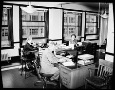 City Light employees in office, 1954 by Seattle Municipal Archives, via Flickr