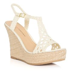 Rock your tanned gams in total comfort with Kaye! Pair this raffia wedge with a high-low hemline or denim mini and cause a little chaos on the boardwalk or at the resort pool. Her braided T-strap evokes breezy summer style.    SHOE DETAILS  Approx. Heel Height: 4 1/2  Approx. Platform Height: 1  Runs True To Size  Synthetic Upper  Man Made Sole  Imported
