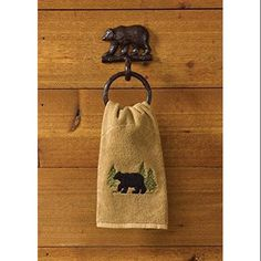 Decorate your bathroom or kitchen with this rustic Black Bear Cast Towel Ring Hook. It is finely detailed and has a dark brown burl finish to replicate cast iron. A beautiful, yet simple piece of decor to add to your home!