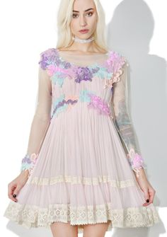 Dolly Bae Lilac Dew Drop Floral Dress is covered in gorgeous wild flowers that catch the morning dew and shine in the sunlight. This romantic long sleeve dress features a semi sheer super soft material that falls over yer frame with a flowing fit and removable interior slip, pastel floral embellished bodice, a whimsical tiered crochet trim skirt and concealed side zipper closure.