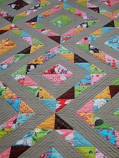 Delicious half square triangle quilt of flea market fancy by cabbagequilts.blogspot.com