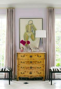Bear Hill Interiors The colors of this nude tie the room together with complementary colors. Artwork by Bill Belew