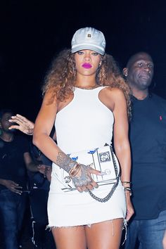 Rihanna wears bright pink lipstick with a white dress and baseball cap to hit the club with Lewis Hamilton