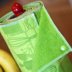 Homemade 'paper' towels using snaps to hold it into an empty cardboard roll