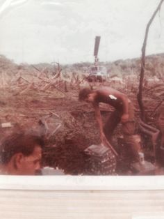 Just getting a few charges ready. 1st Air Calv. Cambodia. Carl Shilling