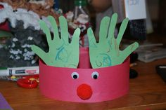 These reindeer hats are easy and so much fun! I made them with three kids, two aged 4 and one 2 years old. It was something they all could do glue (guidelines with our fingers for the two year old) and we ofcourse did the cutting and they colored :)