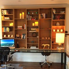 Custom bookshelf by #EagleWoodworking installed in Boston MA apartment - differently sized shelving (for books and/or decor) completely changes the look and feel of many spaces #LifeHack by dovetaildrawers