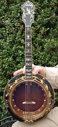 Custom 8 head 19 fret tenor built in American walnut by Dale Small SN: 271. Gold plating and wood finishes are like new. Banjo plays and sounds great! Ebony armrest has the name Ruth inlaid in pearl. OHSC