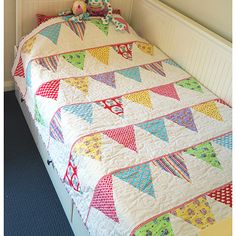 """This fun and vibrant bunting quilt would bring life and colour to any room! Quick and simple!! This pattern is suitable for all skill levels.Completed size: Single bed quilt measures 54"""" x 74"""".Pattern contains full step-by-step instructions and the full sized templates to create your own Celebration Bunting Quilt."""