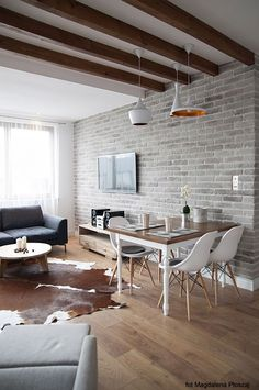 Exposed brick, ceiling beams, wood floors. Love everything about this apartment.